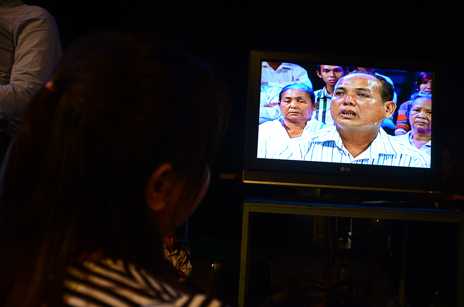 The show's producer Prak Sokhayouk, watches the screen as taping begins for 'It's Not a Dream'. Many of the staffmembers who work on the production are young and did not live through the Khmer Rouge regime.