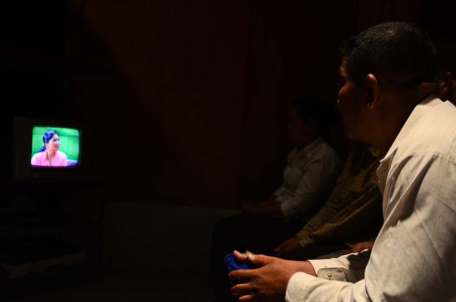 Khoem Sarom watches the show on a television screen backstage. He has not seen his niece since 1979.