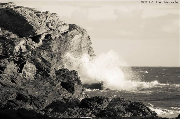 Waves crashing onto the cliffs by Trearddur Bay, Anglesey