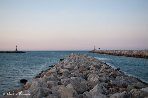 E ntrance to the harbour at Vilamoura Portugal with lighthouses either side - 1/125 second