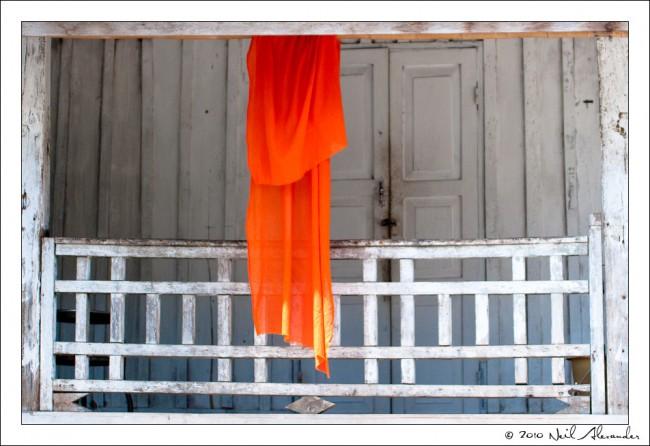 M onk's robe in Wat Visounnarath, Luang Prabang by Neil Alexander