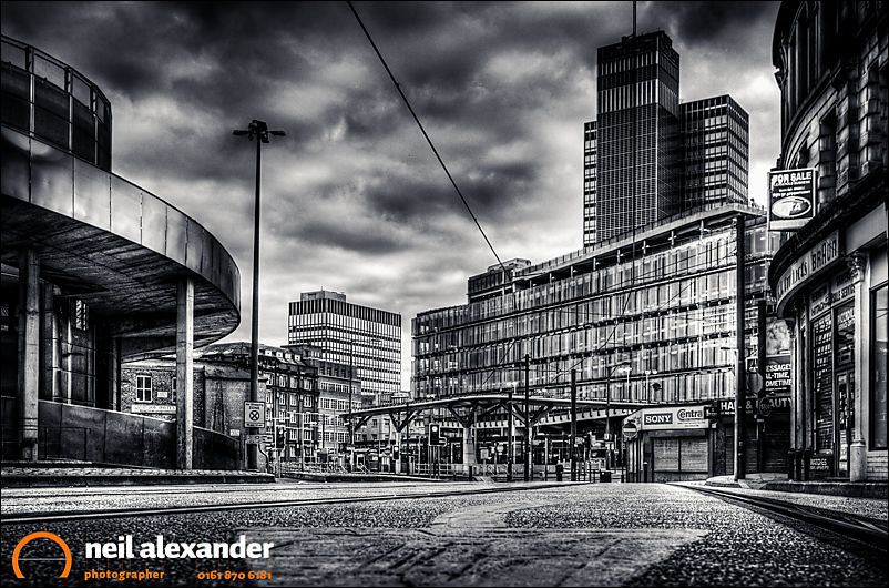 Looking down High Street, Manchester towards Shudehill bus and Metrolink station with the CIS Tower in the background