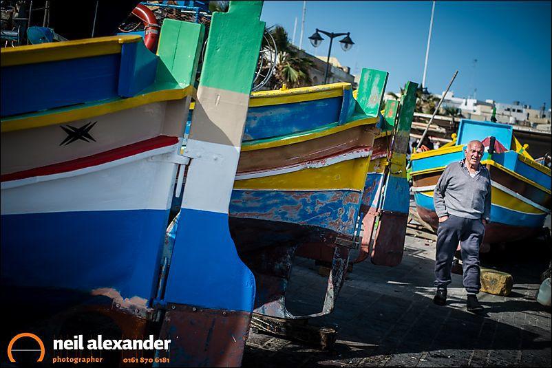 Fisherman inspecting boats in Malta