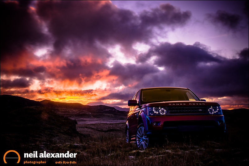 Range Rover Sport in the Welsh hills at dawn