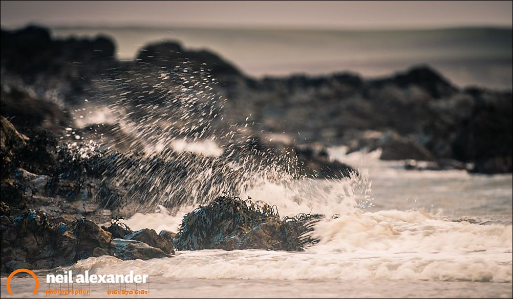Waves crashing on the Rhosneigr beach, Anglesey, Wales, UK. Camera settings: F2.8, 1/50 sec, ISO 200. 200mm