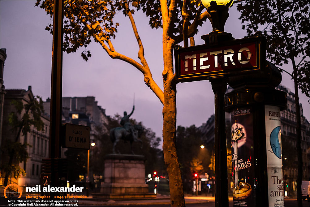 Paris Metro sign at night