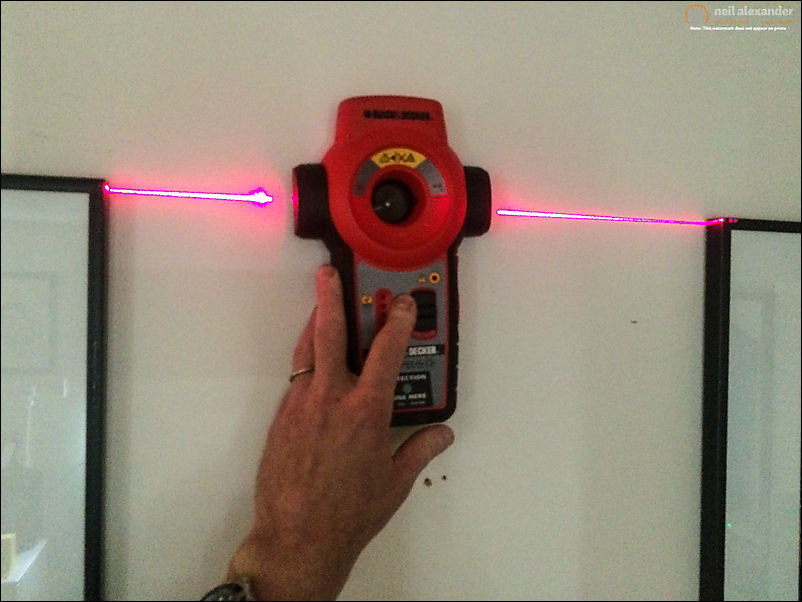 Using a laser level to make sure frames are lined up and aren't wonky.