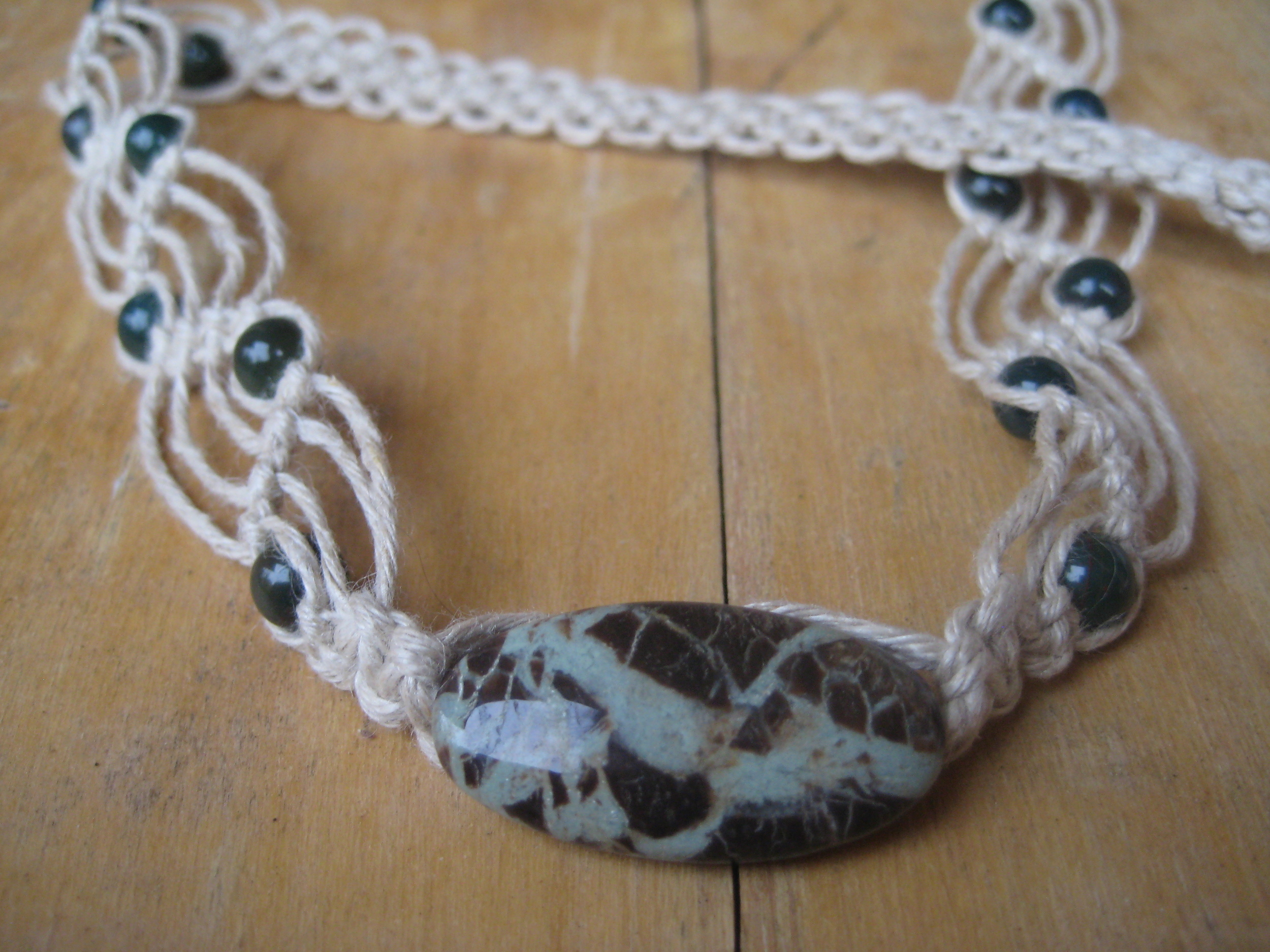 Gorgeous Lake Agate is the focal of this soft, comfy chemical-free hemp necklace. Bloodstone rounds dot the waves. This is a one-of-a-kind piece (that has a coordinating bracelet!) that will be on sale with more macramé soon at www.peridotdaisy.com!