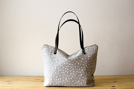 Tote by  Milkhaus Design based out of Madison, Wisconsin. Natural linen is screen printed with non toxic water based inks. I really love her use of simple and natural colors and patterns, especially for a tote that you might want to use everyday. It goes with everything!