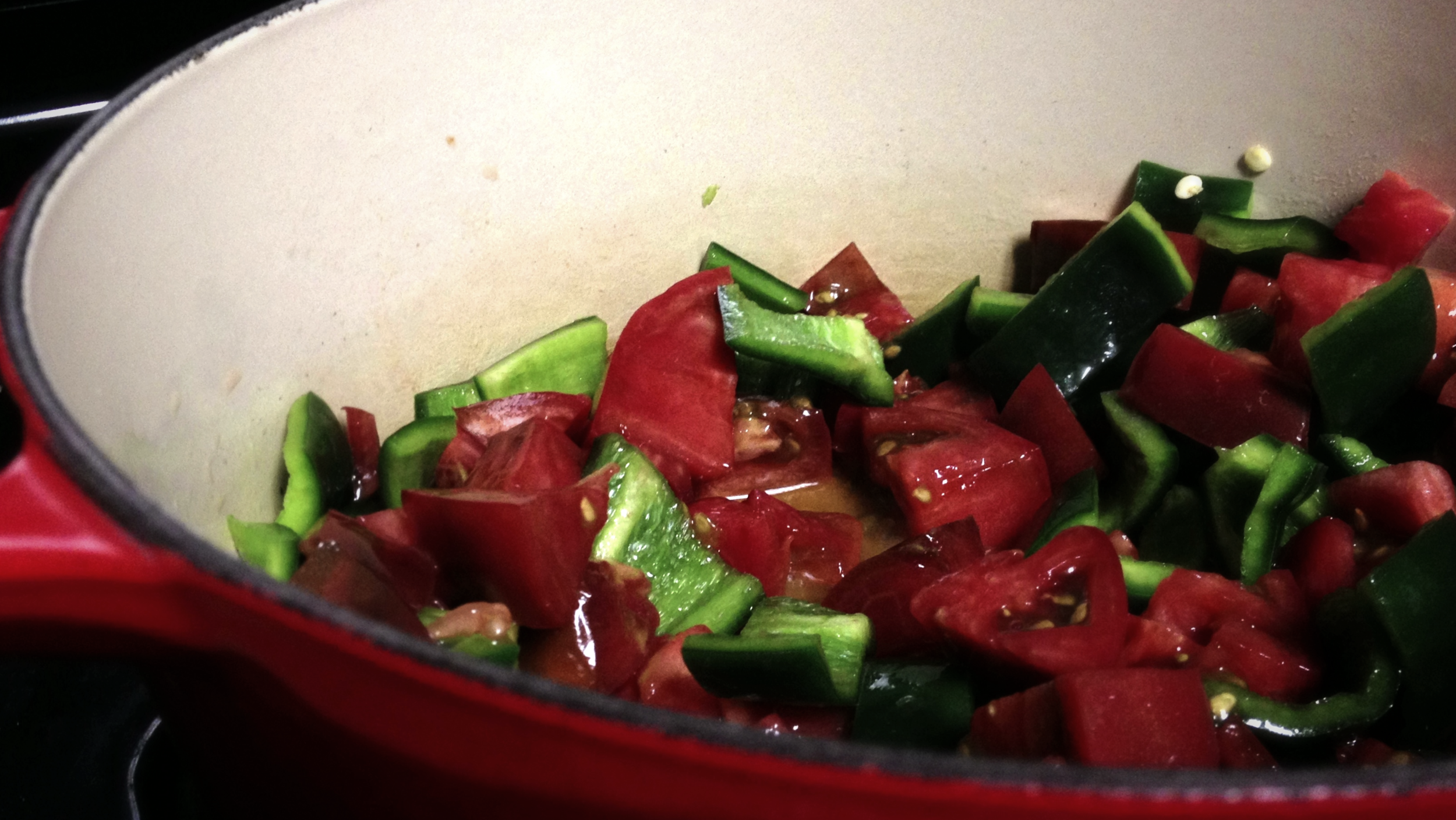 peppers and tomatoes simmering for green chile sauce