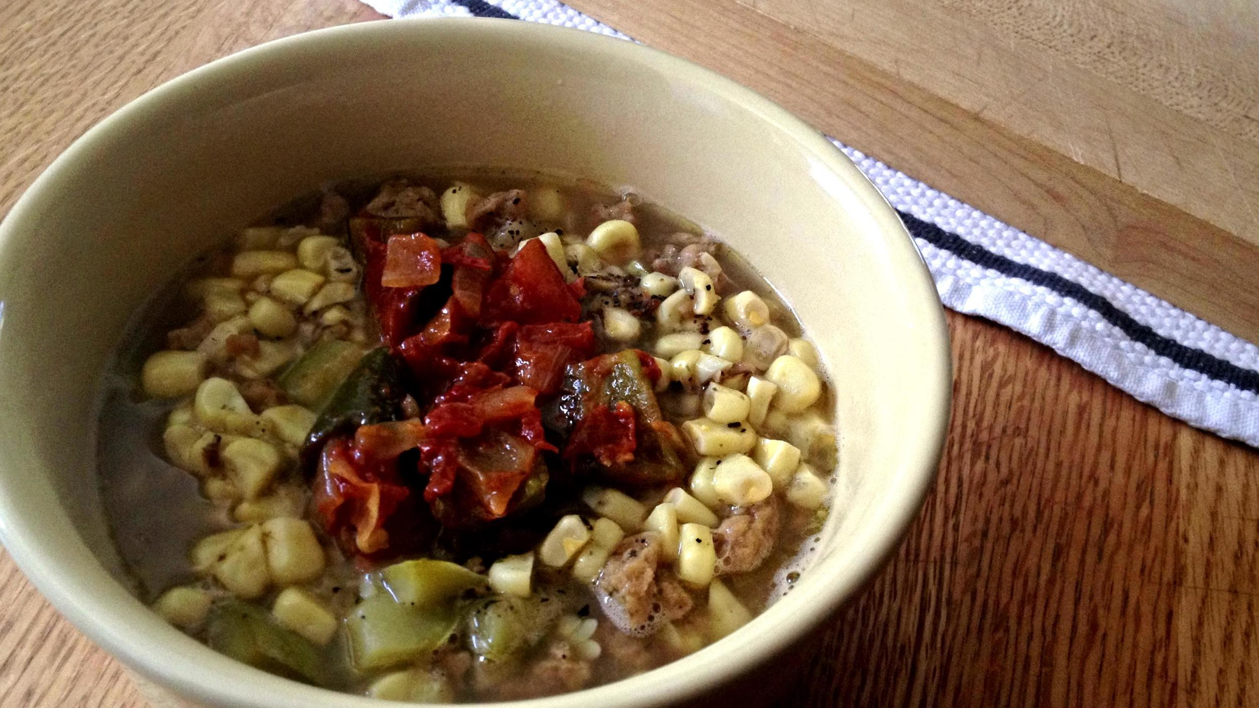 Hopi fresh corn stew topped with green chile sauce