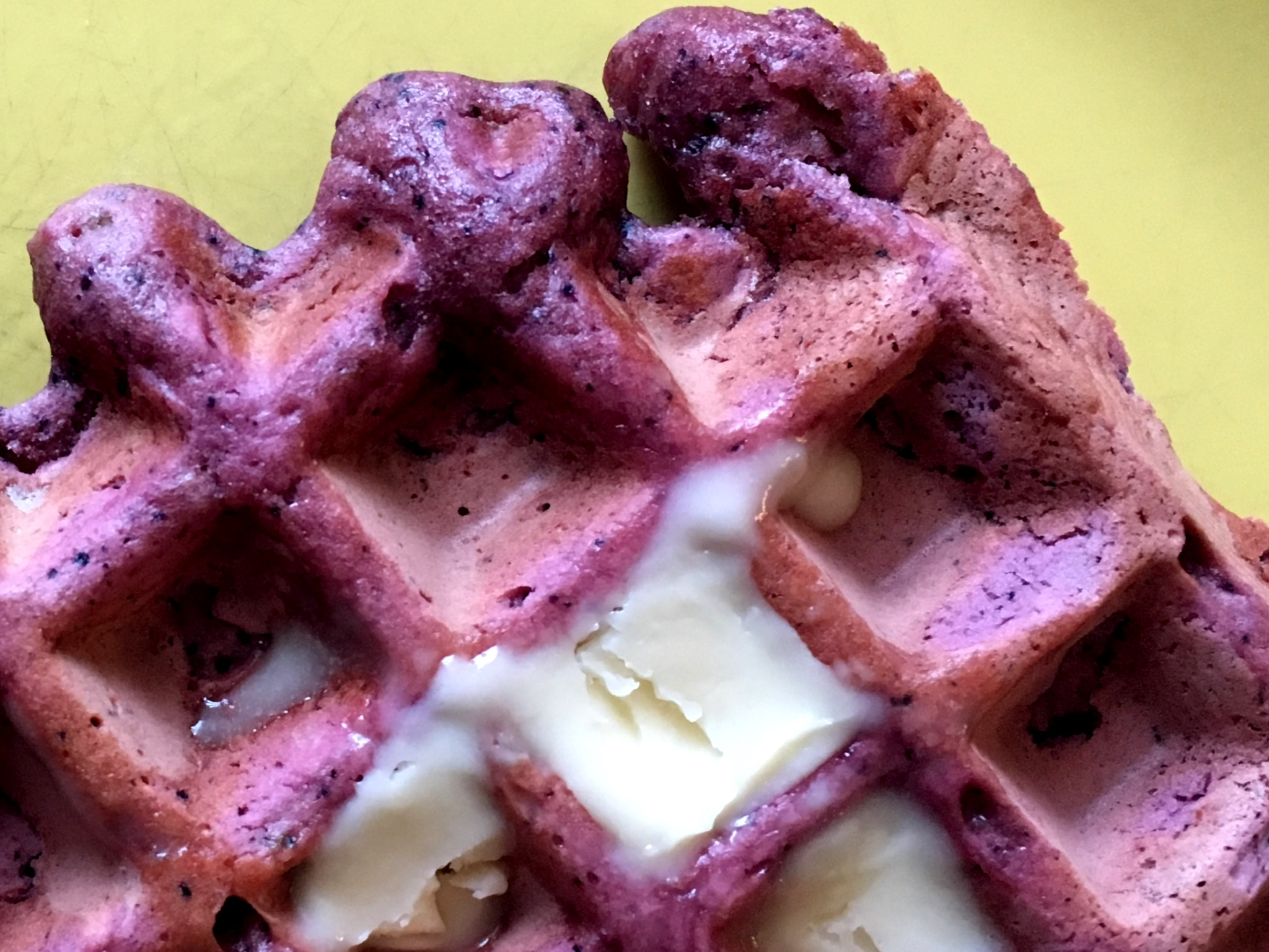Blueberry-beet waffle topped with vegan butter