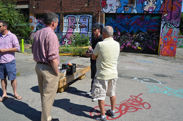 John meets an artist working on one of our free walls.