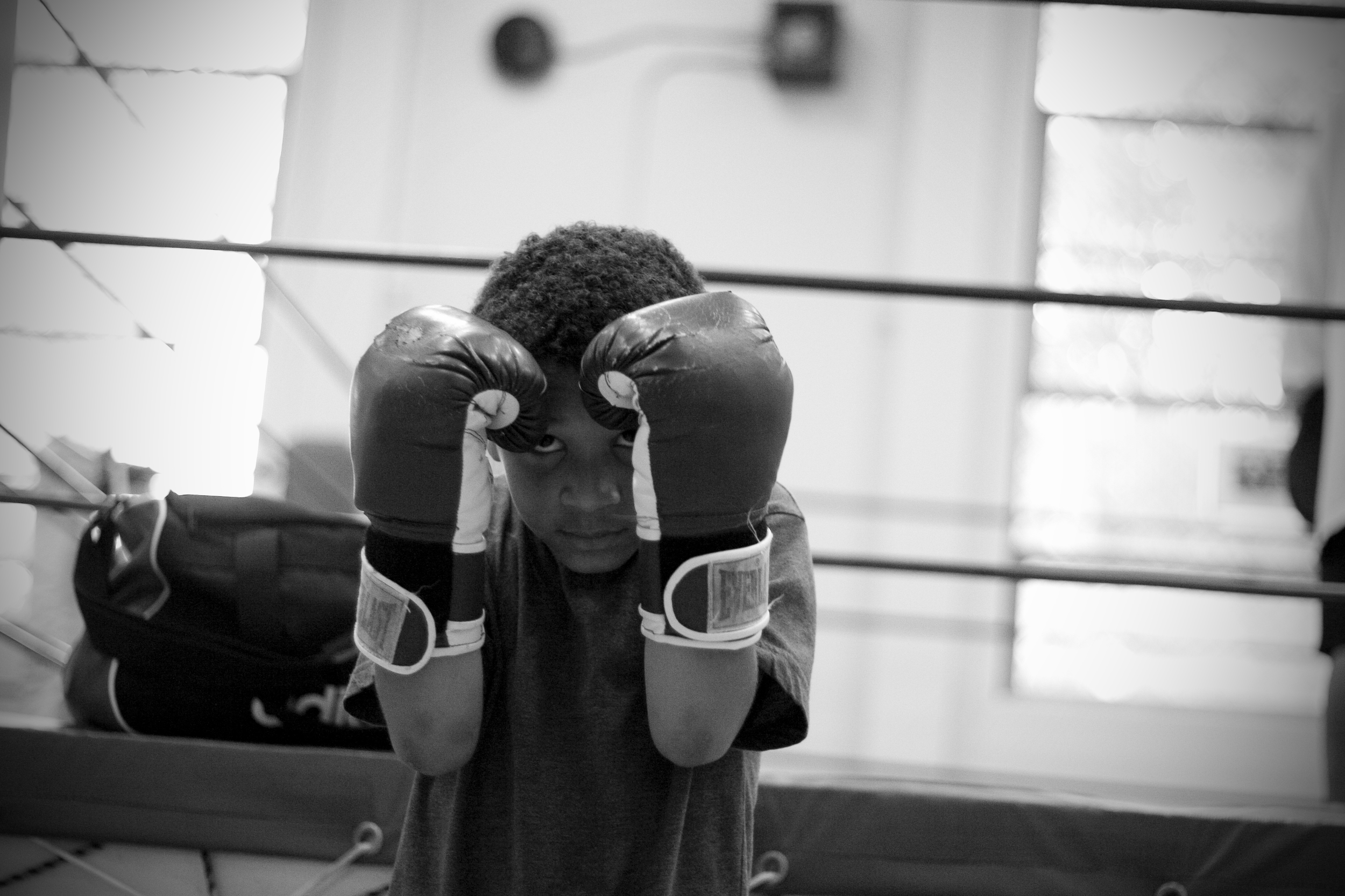 ​Zion Evans, 7, squares off with a punching bag in northeast Portland. Boxers may begin training young, but can't fight until they turn 8. For Zion, that is still five months away.