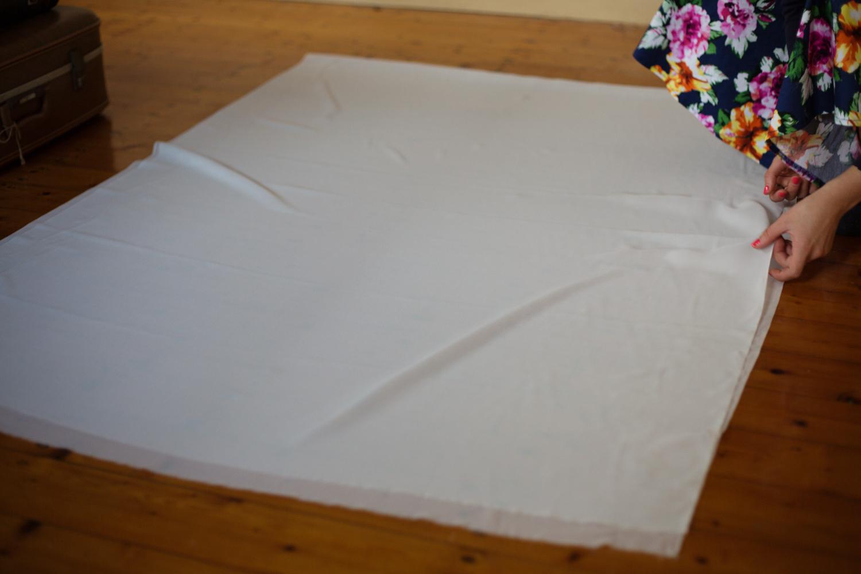 Folding the silk in half