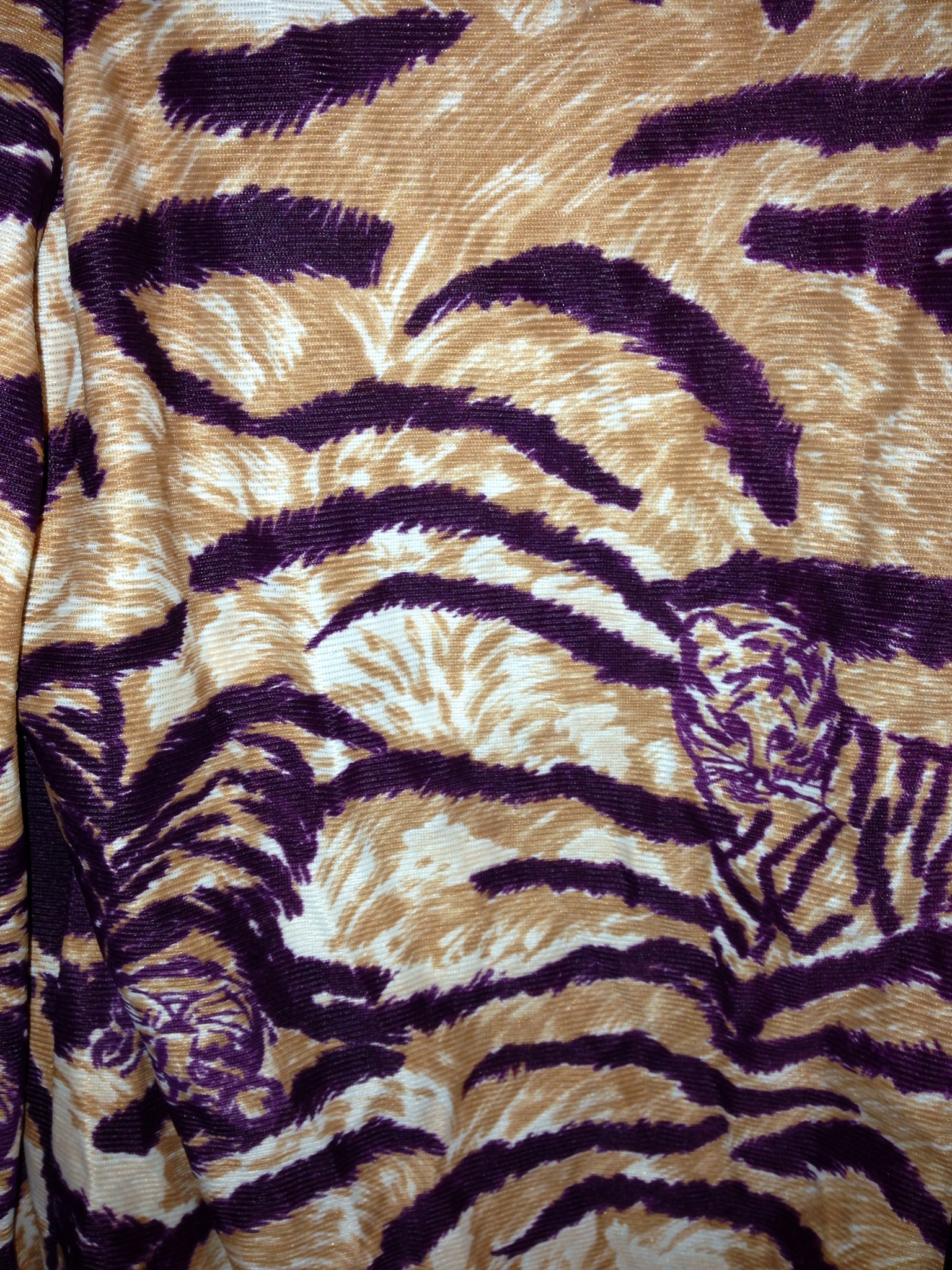 I've been seeing some animals within skin prints. I guess it isn't that new as this is a 70's shirt.