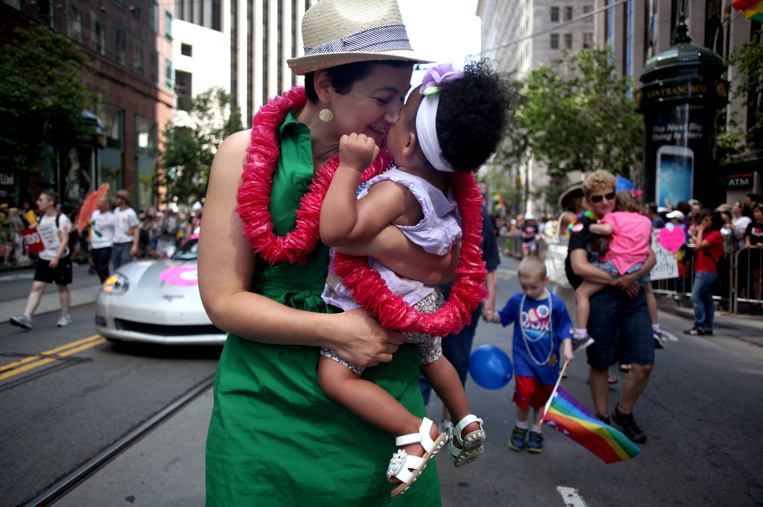 Elana with her happy baby Nia along the parade route.