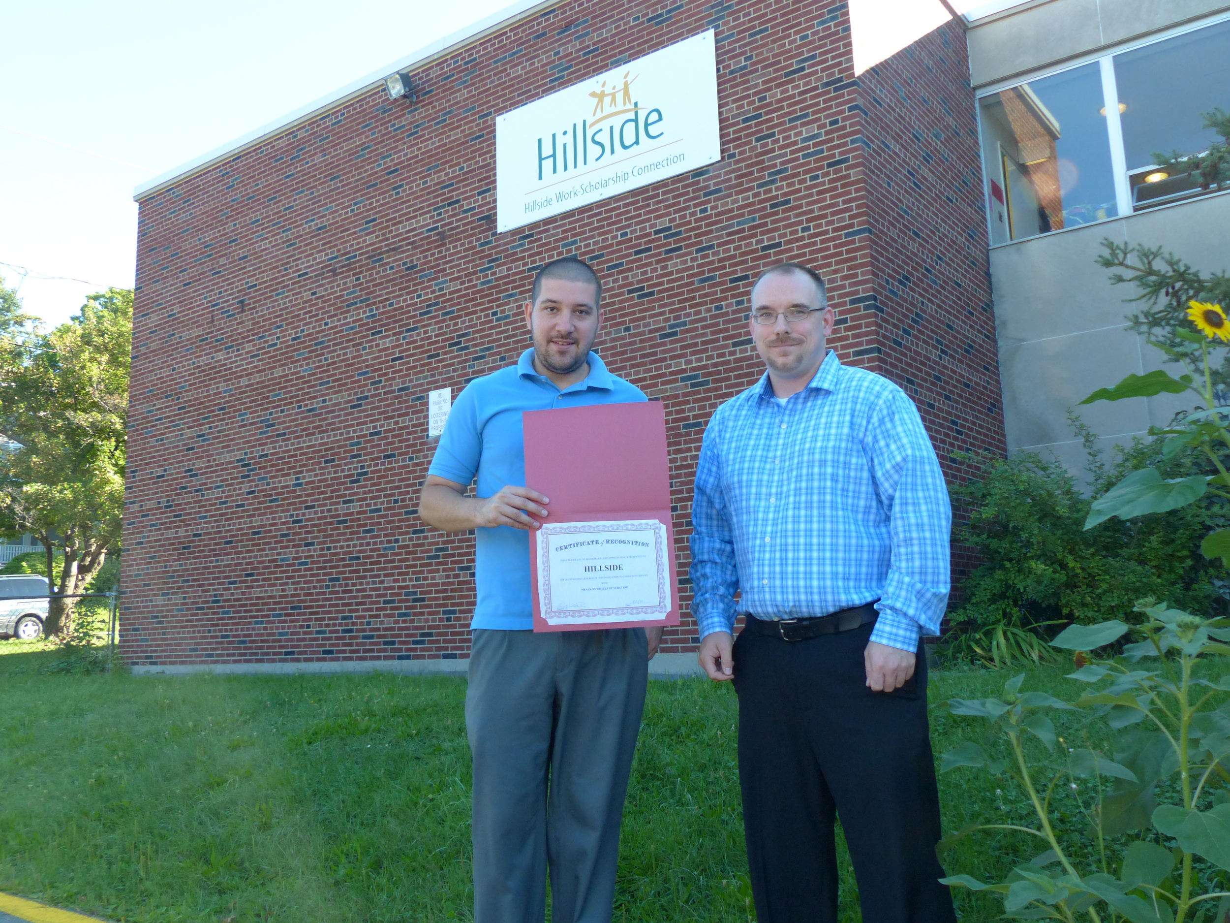 (Pictured L-R) Mike Olsen from Hillside and Michael Watrous from Meals on Wheels of Syracuse