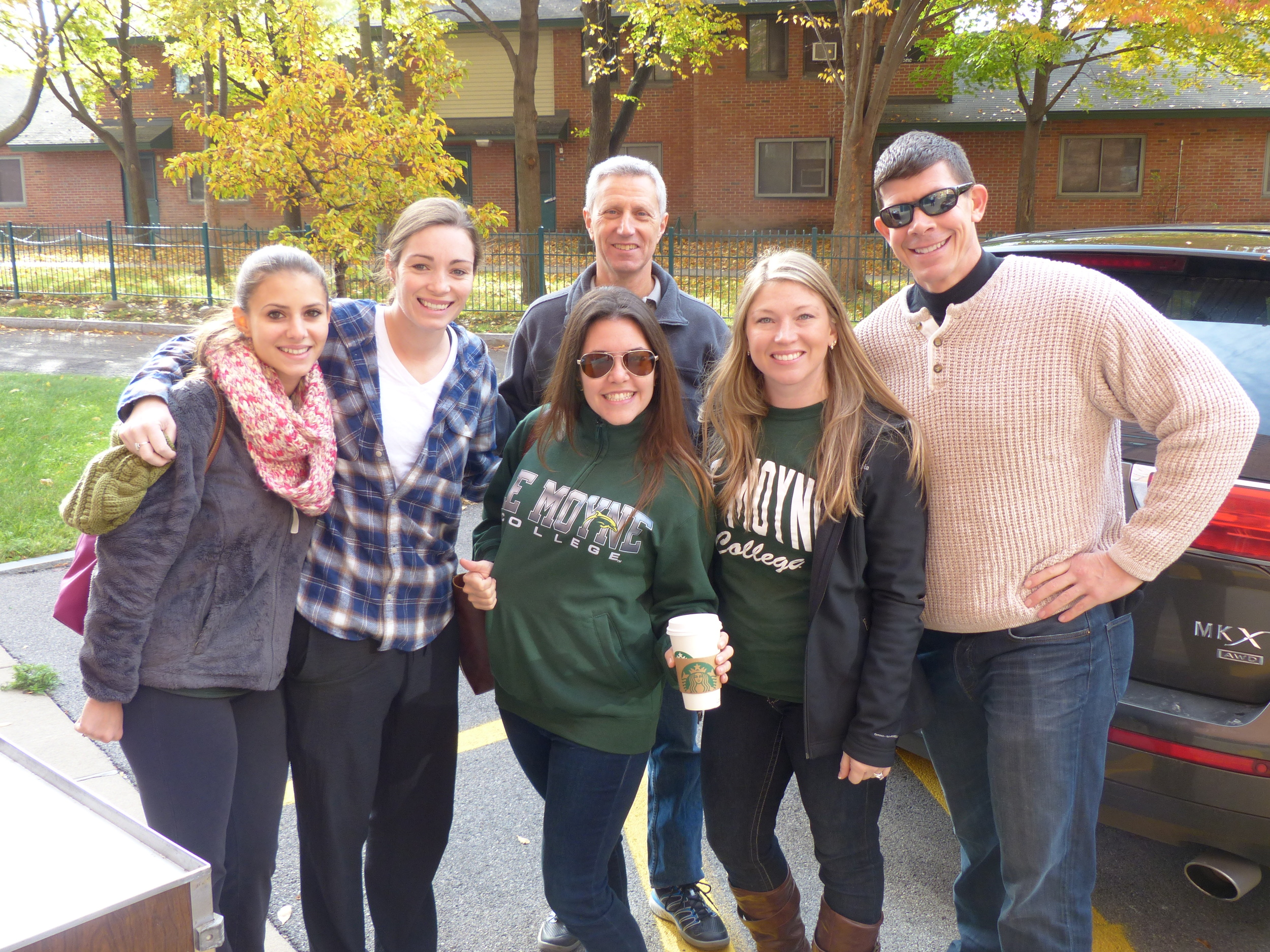 Le Moyne College students and Mason Kaufman, Meals on Wheels Executive Director (back)