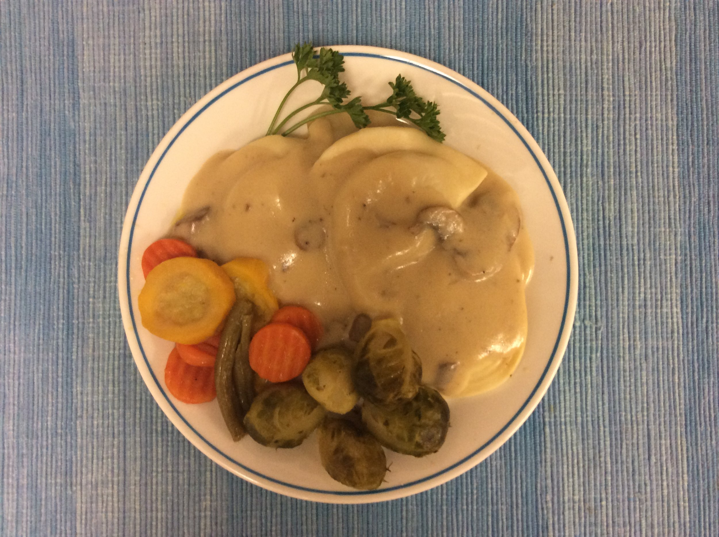 Perogies with golden gravy, capri vegetables, and lemony brussel sprouts