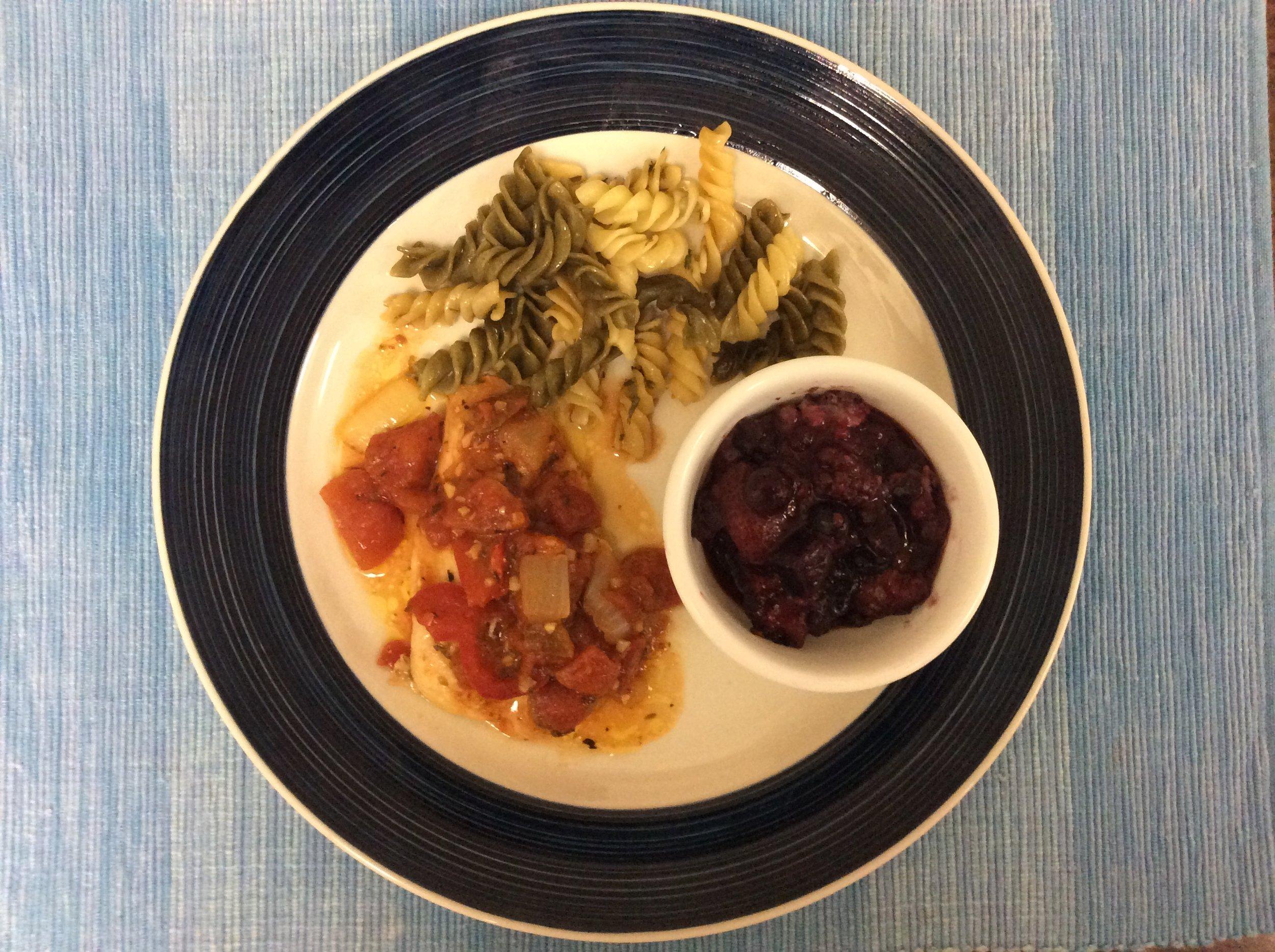 Chicken Cacciatore, tri color rotini, and mixed berry compote