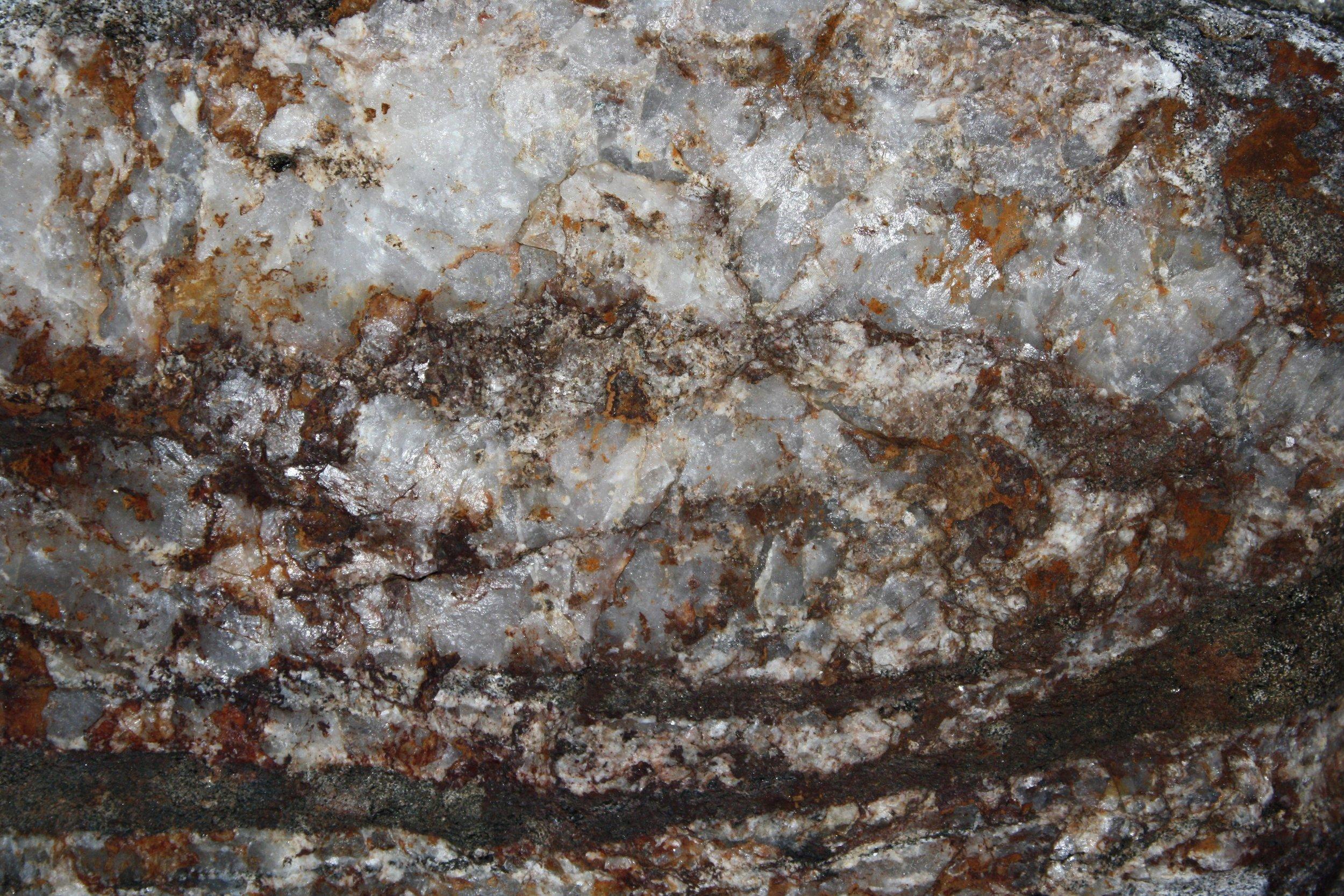 white-quartz-rock-texture-with-hematite-iron-rust-stains.jpg