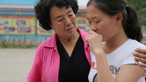 Ms. Zhang with young girl