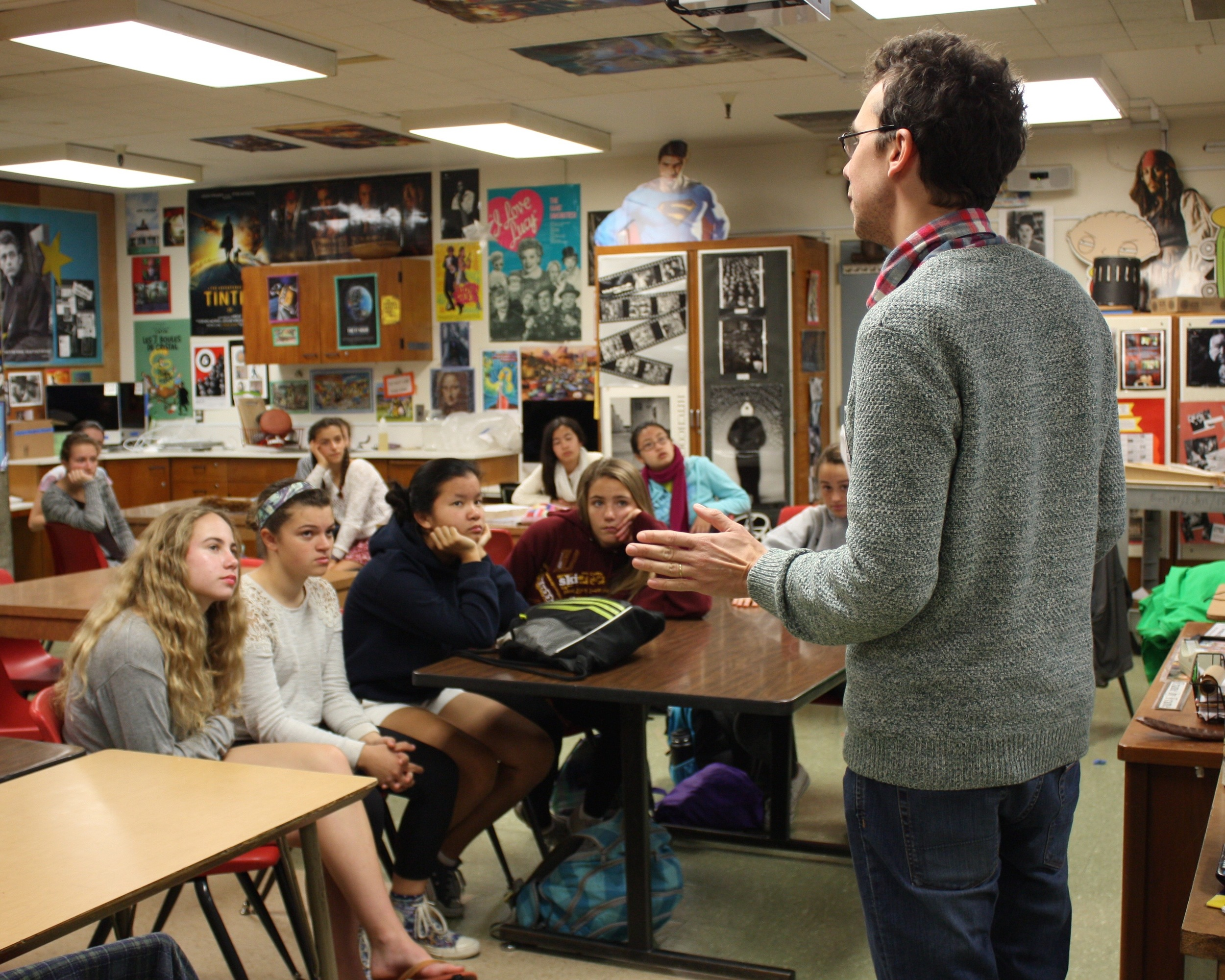 Louis speaking to students about his film