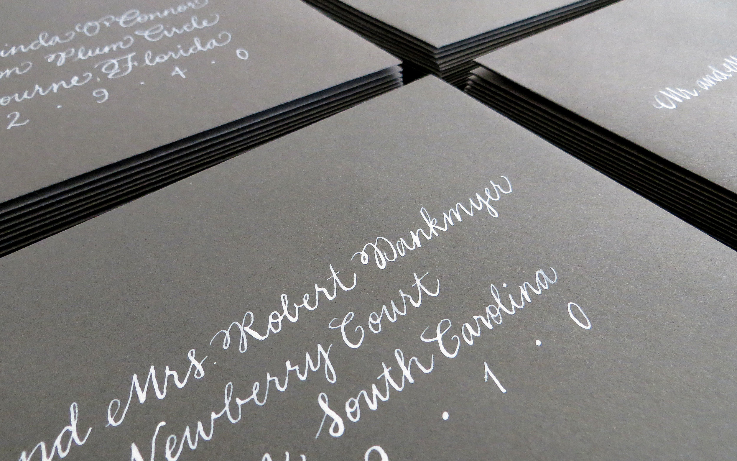 Close-up of calligraphy on mailing envelopes