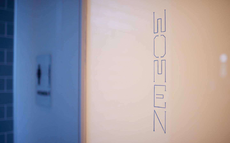 Custom typography on bathroom doors.