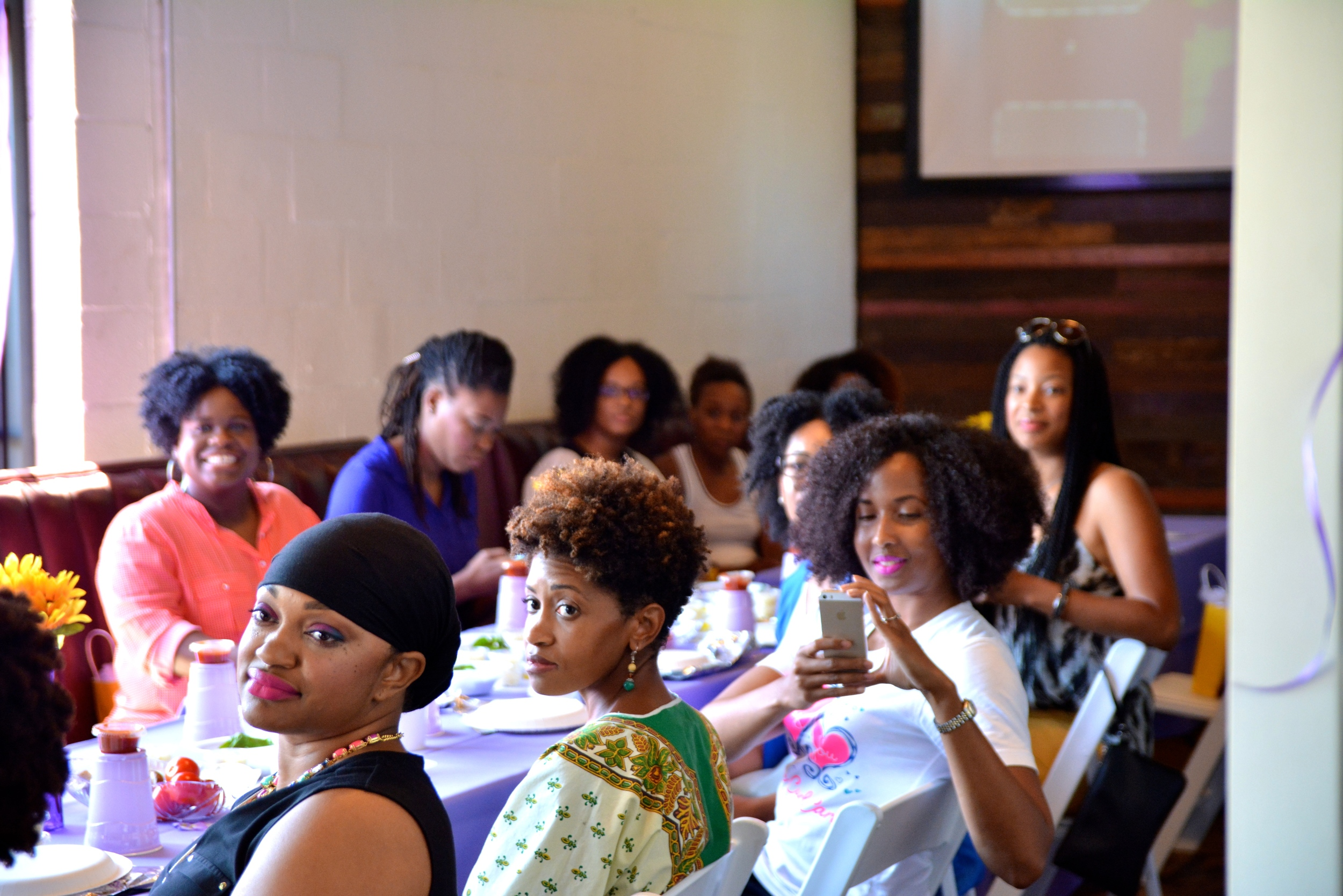 Guests listened to speakers share hair benefits of food ingredients before cooking.