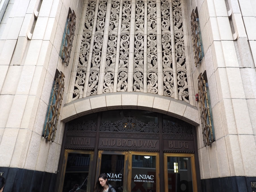 The Ninth & Broadway Building was built in 1930 as an office building. The facade is terracotta textured and coloured to resemble stone. The intricate filagree patterning is of twirled grapevines.