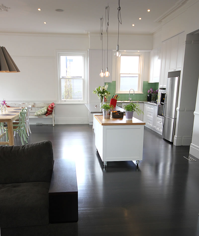 As well as a fixed counter with a stone benchtop, there is a mobile counter with a timber chopping board benchtop which can be wheeled out to the balcony for entertaining. To the right you can just see the entrance to the walk in pantry which has its own bench space and floor to ceiling storage for foodstuffs and small electrical appliances.