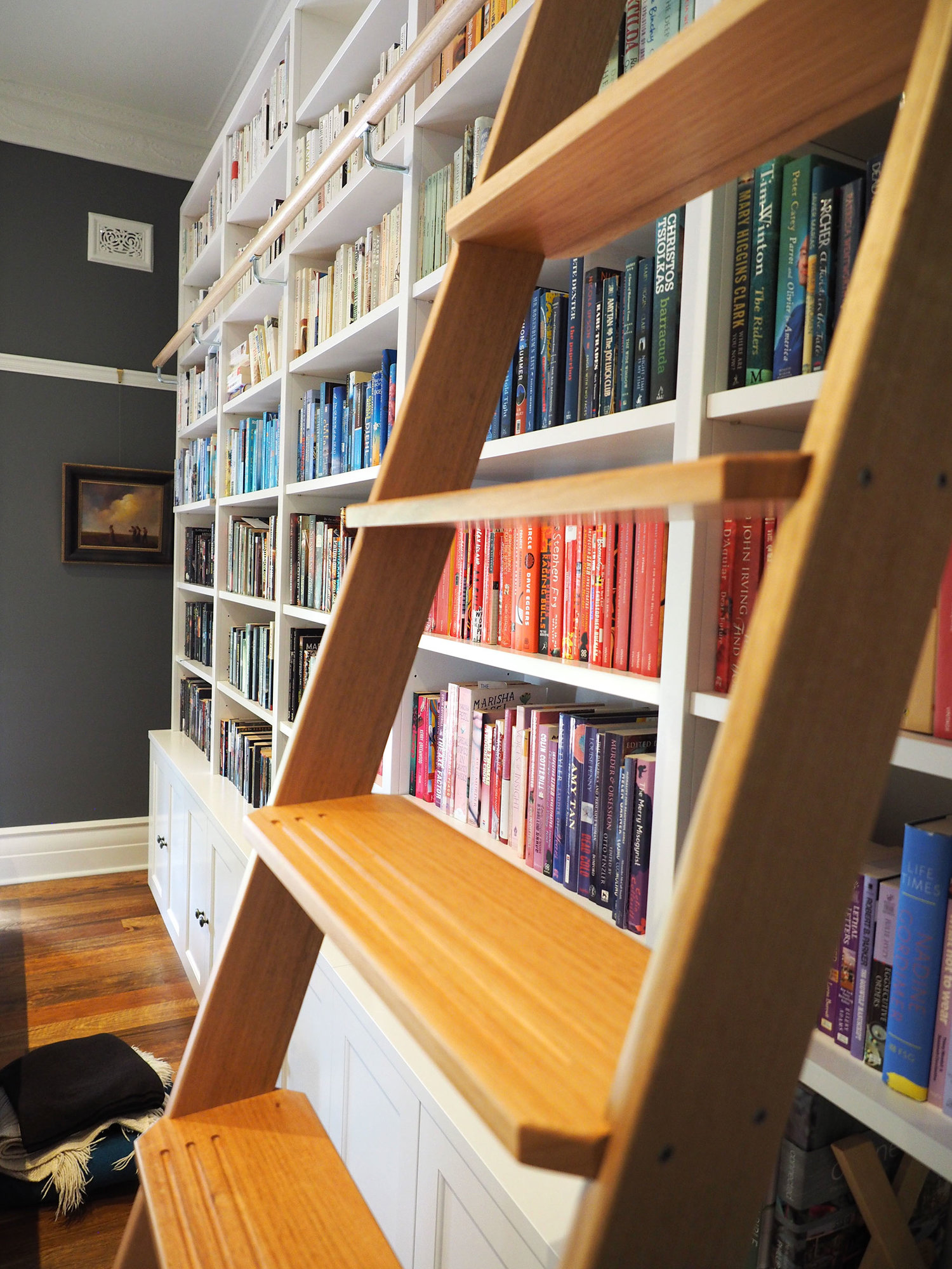 SLIDING LIBRARY LADDERS - A book-lover's dream, masses of custom-built bookcases were tucked into every spot we could find - complete with a hand-made oak sliding ladder to reach all those lovely books.