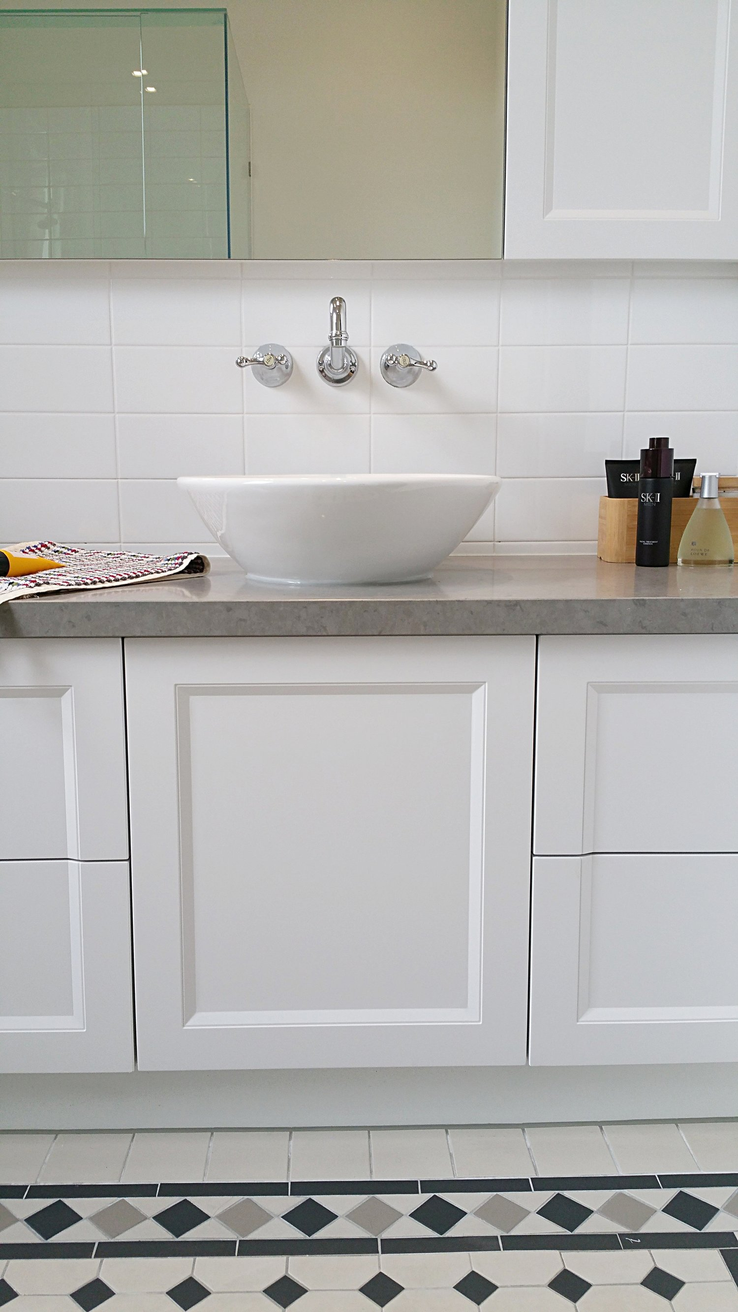QUALITY FITTINGS - Brodware tapware, made in Australia to a high standard of quality, were selected so the bathrooms will last for this young busy family. Benchtops are stone, finishes are matte and colours are quiet to bring a sense of welcome calm to the everyday.