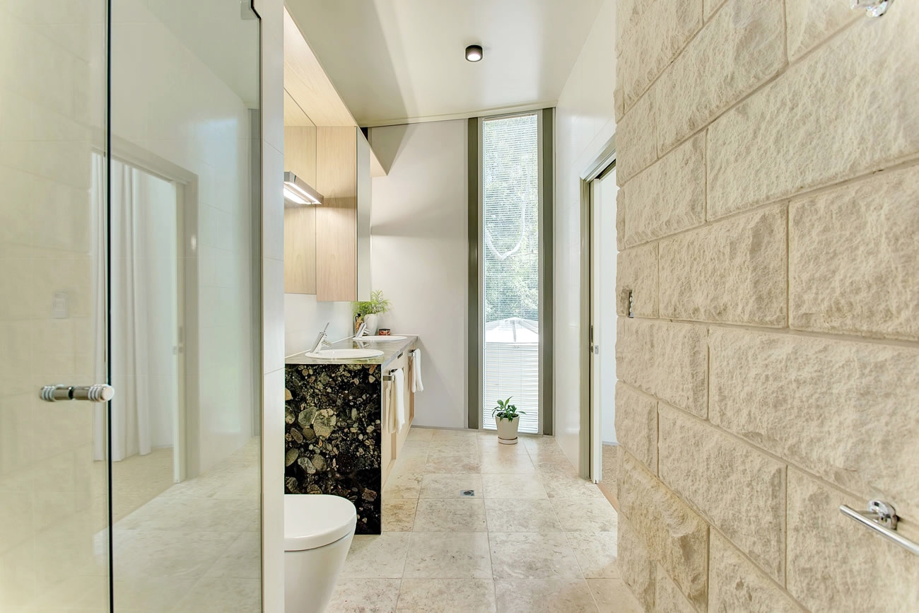 A PALETTE OF NATURAL STONE & TIMBER - Blue Fruit designed a contemporary house in a botanical setting, using solar passive orientation and a luscious palette of natural materials, like mt gambier limestone, blackbutt timber parquet and melaleuca veneer...