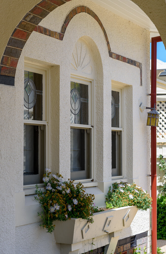 DETAILS - FULL RENOVATION, ALTERATION & RESTORATION.An extraordinarily beautiful house built to a very high standard of detail in Spanish Mission style, circa 1929.The house, which was bought by my clients recently, had been extended a few decades ago, but luckily most of the detailing had been retained in the original part of the house. With glorious arched lead lighting and intricate timber work, the bones of the Spanish Mission design were still there, albeit a little unloved and needing restoration and repair to bring them back to their full beauty.The floor plan of the house was utterly reworked without requiring an additional footprint, as the clients are keen gardeners and wished to retain as much opportunity for a gentle, country-style garden as possible.Externally, the house was given room to breathe, with simplified and sympathetic landscaping, new limewash to the original render, new gutters and downpipes connected to water tanks and new permeable paving forming a carriage driveway and safe paths throughout the garden. Custom designed gates and even a bench seat were built on site to suit the unique Spanish Mission style.Internally, original rooms were given new purposes - including creating a Book Room to the front of the house, for an owner who was a former librarian and loves to be able to easily access her vast collection of titles. Book cases are tucked all over the house: some as floor mounted units and some as high level book shelves which are accessed by a new sliding library ladder. Every room was reworked and updated, bringing this very beautiful home back to life.Builder: Genjusho. Joiner: Peter Gill Kitchens.Photography: V Style.