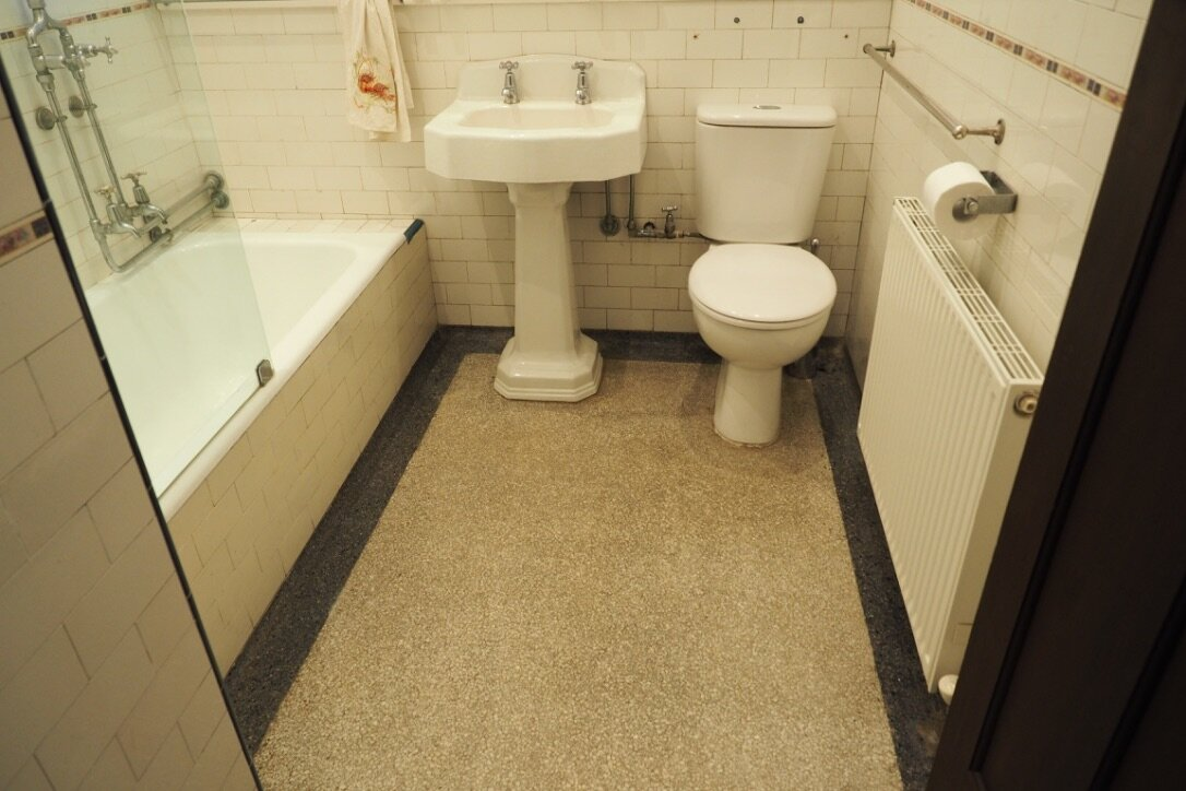 BEFORE - Earlier renovations had retained many of the original features, like the terrazzo floor, pedestal basin and drop in steel bath in the main bathroom. (Seen here in a photo snapped on the first day my clients owned the house.)We retained these elements, restoring and repairing them wherever possible, and removed unsympathetic alterations.New elements were selected to enhance the essence of the Spanish Mission character, and to honour the quality of fittings that had originally been sourced.