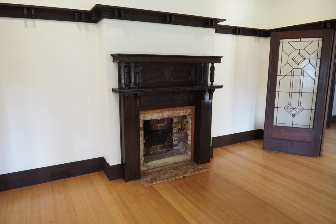 Before: an empty fireplace with firebox long gone