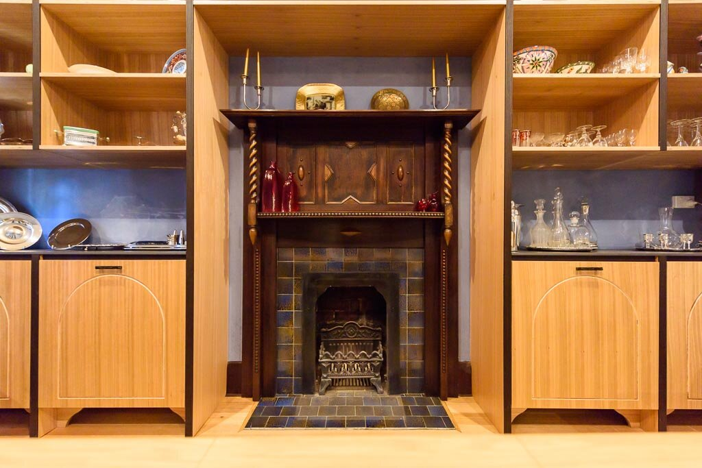 the tiles that started it all… - The 1929 blue and brown glazed tiles on the fireplace which formed the springboard for the colour scheme, are now happily surrounded by new custom joinery to house wine and serving ware.