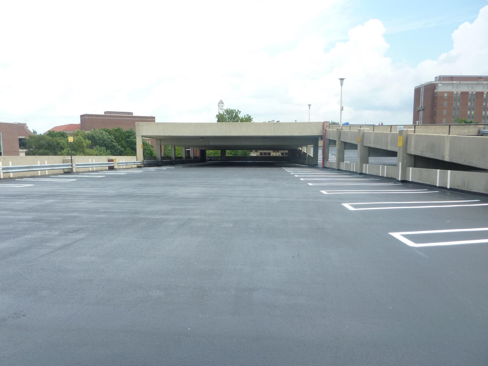 Applied dark traffic coating on the upper level of the University Street Parking Garage