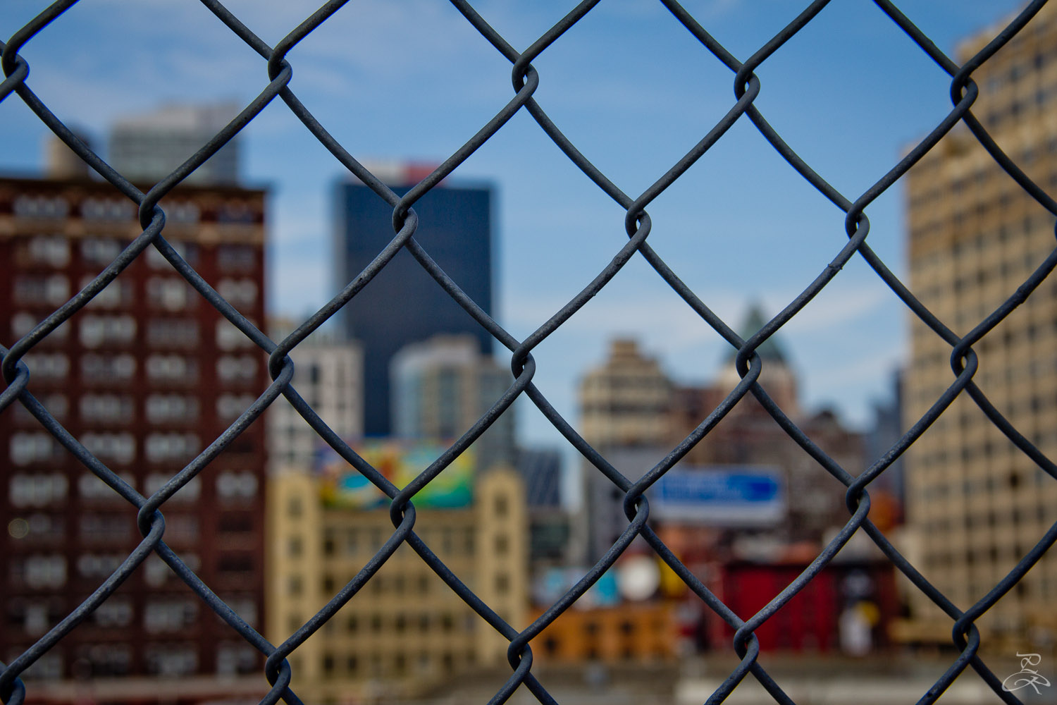 A caged view from the highline. Manhattan, NY.