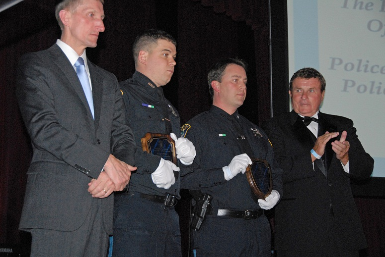 Commissioner Evans, Officer Puopolo, Officer Rooney and President Bob Long