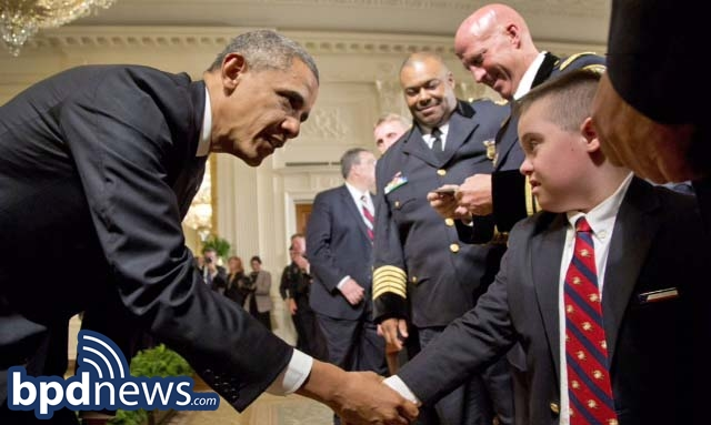 President Obama shakes hands with Brayden Gero, the son of Boston Police Officer Jarrod Gero during a ceremony to honor the nation's top cops.