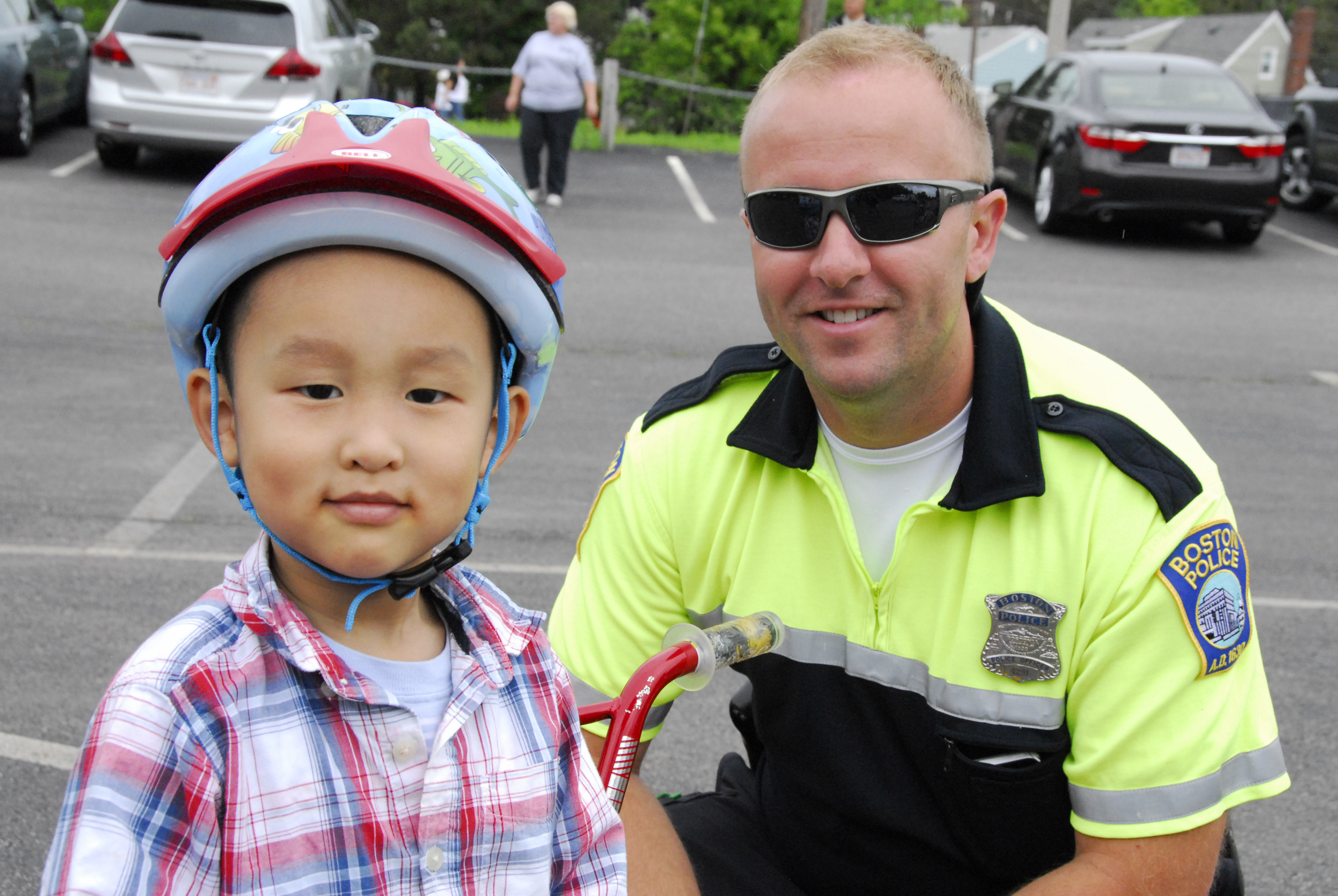 Officer Dario Fancelli hanging with one of his new friends at the District C-11 Bike Rodeo