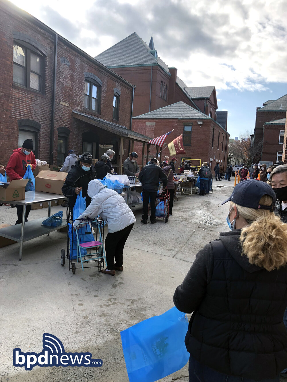 Bureau of Community Engagement Teams Up with Local Parish to Distribute Groceries to Those in Need in Charlestown