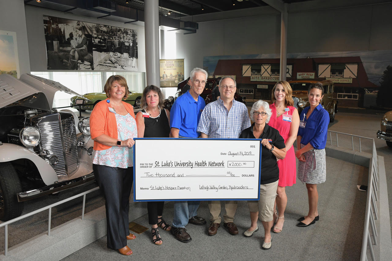 In front of an audience of classic cars, Lehigh Valley Garden Railroaders presented a generous gift of $2,000 to St. Luke's Hospice at the America on Wheels Museum. The gift was made in memory of the group's long-time treasurer, Barbara Karkutt, who was a faithful member and train enthusiast. St Luke's sent a big thanks to the Railroaders for their thoughtful support and for enabling St. Luke's Hospice to care for all patients and families in need.