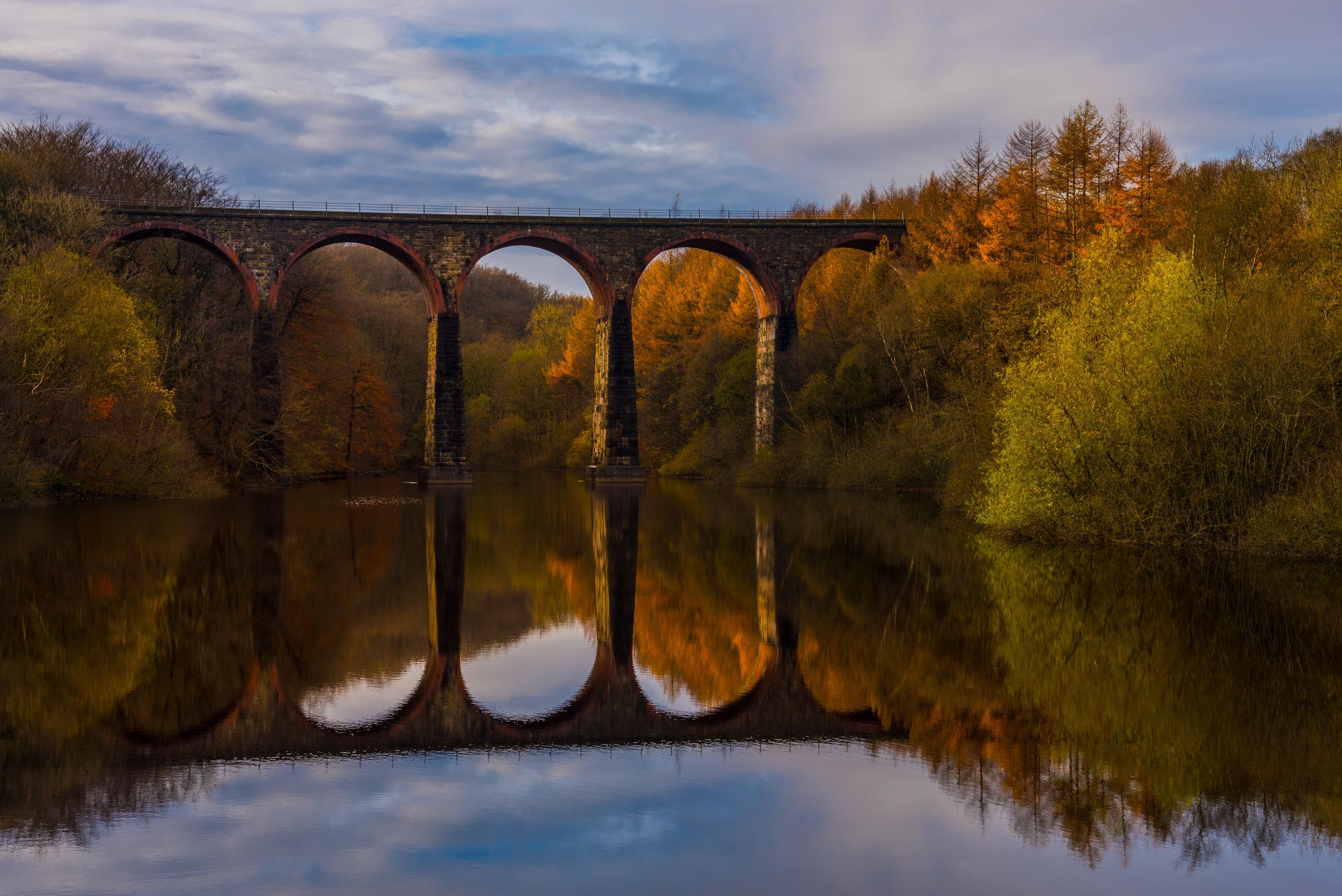 Entwistle viaduct, embraced by autumn colours.