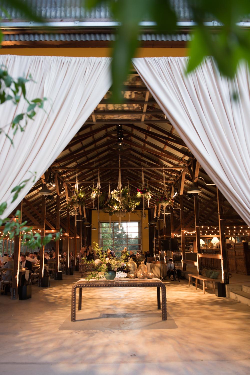 Sylvie-Gil-film-destination-photography-bohemian-colorful-macrame-Napa-wedding-barn-reception-evening.jpg