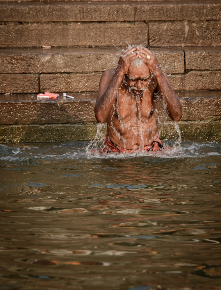 A worshipper bathing in the Ganges.